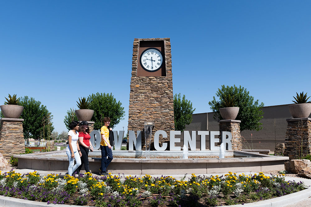 Photo of Town Center entry sign with water fountain and clock